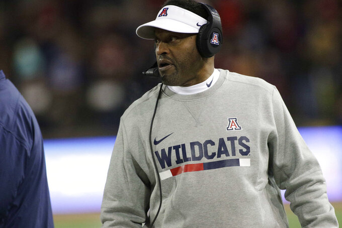 "File-This Nov. 17, 2018, file photo shows Arizona head coach Kevin Sumlin walking on the sideline during the first half of an NCAA college football game against Washington State in Pullman, Wash. ""We've got a lot to play for still,"" Sumlin said. ""It's a rivalry game. It's the Territorial Cup. A chance for the postseason. There really shouldn't be anything I've got to say to get guys to go."" (AP Photo/Young Kwak, File)"