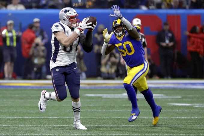New England Patriots' Rob Gronkowski (87) catches a pass in front of Los Angeles Rams' Samson Ebukam (50) during the second half of the NFL Super Bowl 53 football game Sunday, Feb. 3, 2019, in Atlanta. (AP Photo/David J. Phillip)