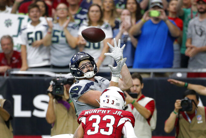 Seattle Seahawks tight end Will Dissly pulls in a touchdown pass as Arizona Cardinals cornerback Byron Murphy (33) defends during the first half of an NFL football game, Sunday, Sept. 29, 2019, in Glendale, Ariz. (AP Photo/Rick Scuteri)