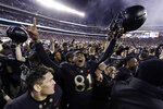 FILE - In this Dec. 8, 2018, file photo, Army's Ke'Shaun Wells celebrates after an NCAA college football game against Navy in Philadelphia. The 120th Army-Navy game is set for Saturday in Philadelphia.  Army is trying to win its fourth straight game in the series.  (AP Photo/Matt Slocum, FIle)