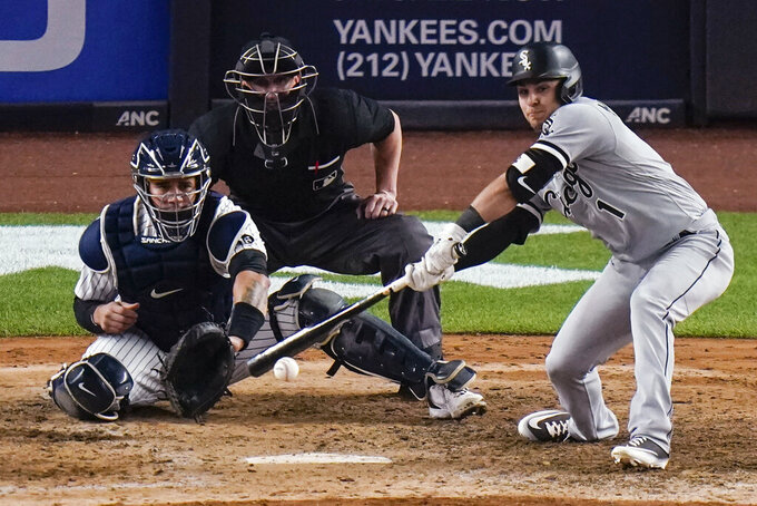 Chicago White Sox's Nick Madrigal hits an RBI single during the eighth inning of the team's baseball game against the New York Yankees on Friday, May 21, 2021, in New York. (AP Photo/Frank Franklin II)