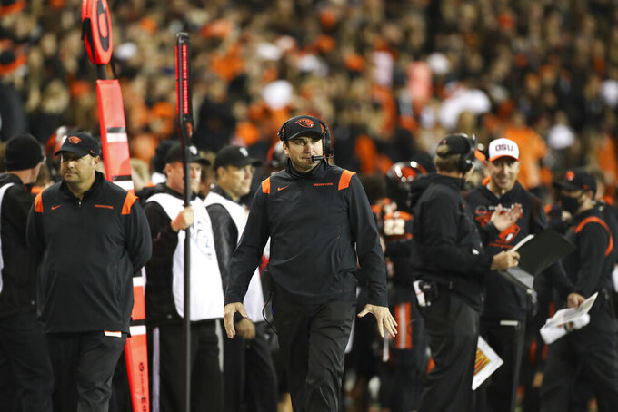 Oregon State coach Jonathan Smith walks the sideline during the second half of the team's NCAA college football game Saturday, Oct. 23, 2021, in Corvallis, Ore. (AP Photo/Amanda Loman)