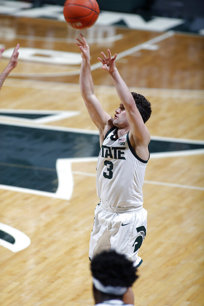 Michigan State's Foster Loyer shoots against Eastern Michigan during the second half of an NCAA college basketball game Wednesday, Nov. 25, 2020, in East Lansing, Mich. Michigan State won 83-67. (AP Photo/Al Goldis)