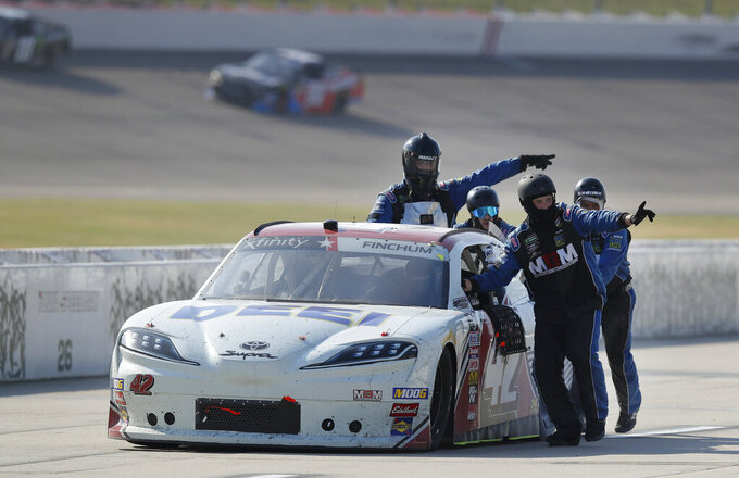 Chad Finchum is escorted off pit road by his crew leads early in the NASCAR Xfinity Series auto race, Saturday, July 27, 2019, at Iowa Speedway in Newton, Iowa. (AP Photo/Matthew Putney)
