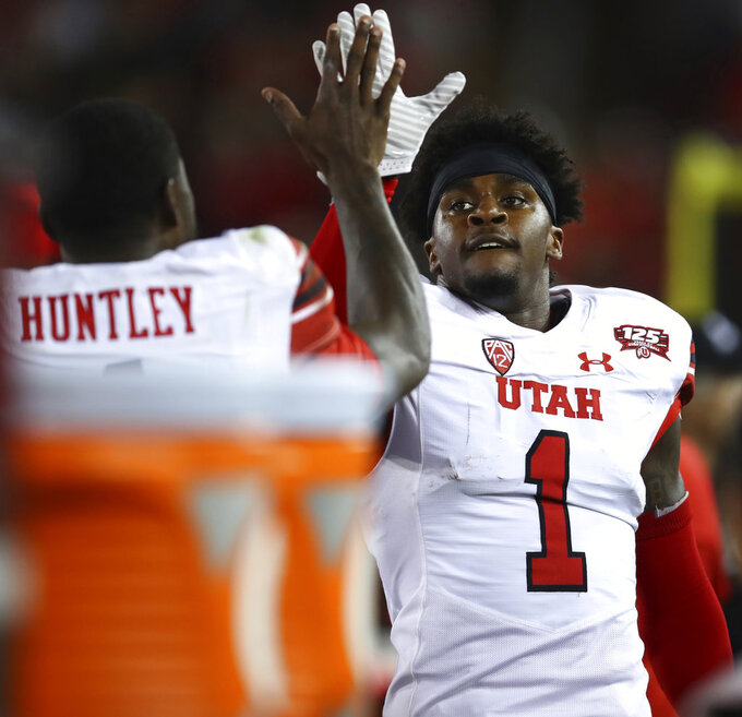 Utah's Jaylon Johnson (1) celebrates with Tyler Huntley after scoring a touchdown against Stanford during the first half of an NCAA college football game Saturday, Oct. 6, 2018, in Stanford, Calif. (AP Photo/Ben Margot)