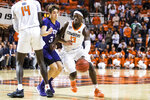 Oklahoma State's 13 Issac Likekele dribbles around a screen set by Yor Anei on TCU's Francisco Farabello during an NCAA college basketball game Wednesday, Feb. 5, 2020, in Stillwater, Okla. (Devin Lawrence/Tulsa World via AP)