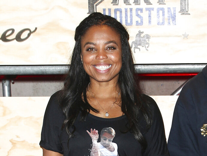 FILE - This Feb. 3, 2017 file photo shows Jemele Hill at ESPN: The Party 2017 in Houston, Texas. The former ESPN host, best known to the non-sports world for tweets about President Donald Trump that provoked the White House to unsuccessfully seek her firing, launches a weekly podcast Monday on Spotify. Called