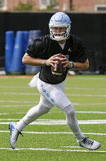 FILE - In this Aug. 2, 2019, file photo, North Carolina quarterback Sam Howell (7) is shown during an NCAA college football practice in Chapel Hill, N.C. This former top-100 prospect verbally committed to Florida State in April 2018 but selected North Carolina during the December signing period after former Seminoles offensive coordinator Walt Bell left to take over Massachusetts' program. (AP Photo/Gerry Broome, File)