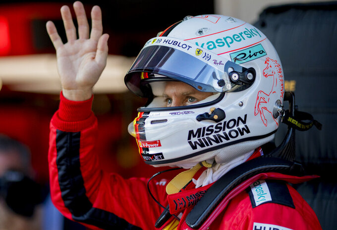 Scuderia Ferrari Mission Winnow's Sebastian Vettel waves during the Formula One pre-season testing session at the Barcelona Catalunya racetrack in Montmelo, outside Barcelona, Spain, Friday, Feb. 21, 2020. (AP Photo/Joan Monfort)