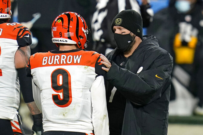 Pittsburgh Steelers quarterback Ben Roethlisberger, right, visits with Cincinnati Bengals quarterback Joe Burrow (9) following an NFL football game, Sunday, Nov. 15, 2020, in Pittsburgh. (AP Photo/Keith Srakocic)