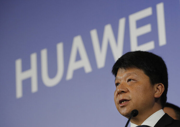 Huawei Rotating Chairman Guo Ping, center, speaks during a press conference in Shenzhen city, China's Guangdong province, Thursday, March 7, 2019. Chinese tech giant Huawei is launching a U.S. court challenge to a law that labels the company a security risk and would limit its access to the American market for telecom equipment. (AP Photo/Kin Cheung)