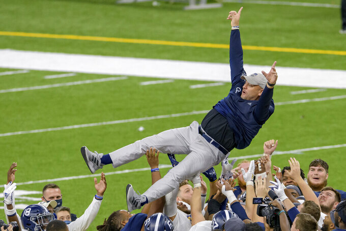 Georgia Southern coach Chad Lunsford and players celebrate a victory over Louisiana Tech in the New Orleans Bowl NCAA college football game in New Orleans, Wednesday, Dec. 23, 2020. (AP Photo/Matthew Hinton)