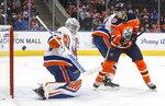 New York Islanders goalie Robin Lehner (40) makes a save against Edmonton Oilers' Alex Chiasson (39) during second-period NHL hockey game action in Edmonton, Alberta, Thursday, Feb. 21, 2019. (Jason Franson/The Canadian Press via AP)