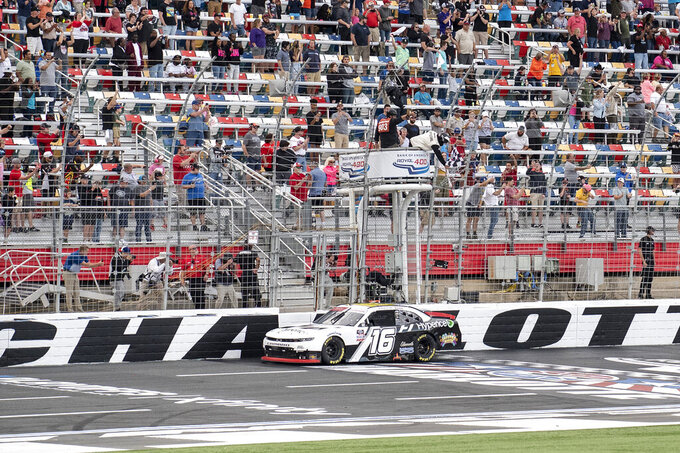 NASCAR Xfinity Series driver AJ Allmendinger (16) takes the checkered flag to win the NASCAR Xfinity auto racing race at the Charlotte Motor Speedway Saturday, Oct. 9, 2021, in Concord, N.C. (AP Photo/Matt Kelley)