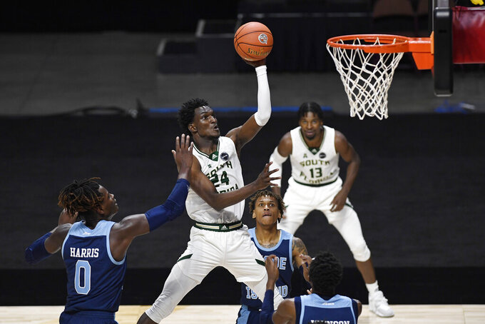 South Florida's Jamir Chaplin (24) goes up for a basket against Rhode Island during the second half of an NCAA college basketball game Saturday, Nov. 28, 2020, in Uncasville, Conn. (AP Photo/Jessica Hill)