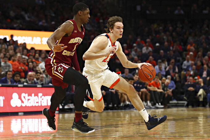 Virginia guard Kody Stattmann, right, is defended by Boston College's Jairus Hamilton during an NCAA college basketball game Wednesday, Feb. 19, 2020, in Charlottesville, Va. (Erin Edgerton/The Daily Progress via AP)
