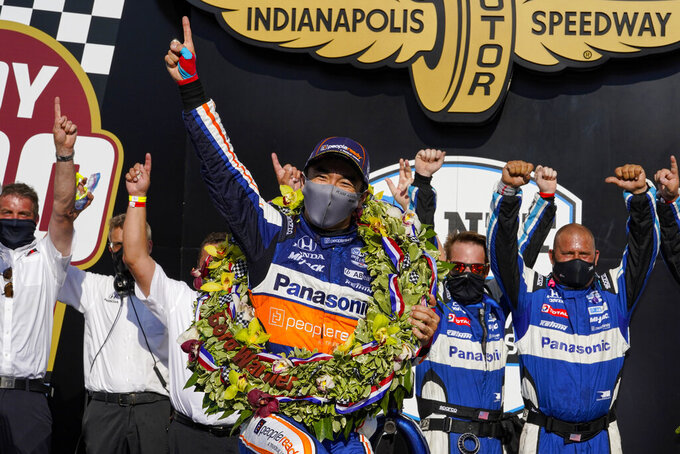 Takuma Sato, of Japan, and team members celebrate his win in the Indianapolis 500 auto race at Indianapolis Motor Speedway in Indianapolis, Sunday, Aug. 23, 2020. (AP Photo/Michael Conroy)