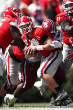 Georgia quarterback Jake Fromm (11) is sacked by South Carolina defensive lineman Javon Kinlaw (3) in the first half of an NCAA college football game Saturday, Oct. 12, 2019, in Athensw. (AP Photo/John Bazemore)