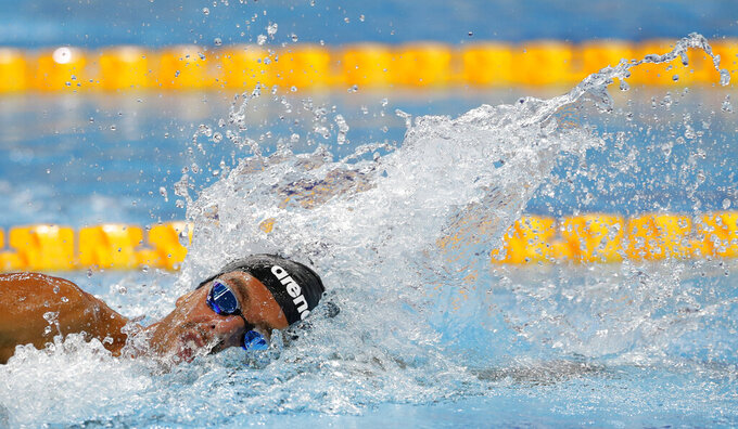 """FILE - In this Saturday, May 22, 2021 filer photo, I taly's Gregorio Paltrinieri competes during the men's 1500 meters freestyle finals at the European Aquatics Championships in Duna Arena in Budapest, Hungary. Italian swimmer Gregorio Paltrinieri has contracted mononucleosis, raising questions over whether he'll be able to defend his gold medal in the 1,500-meter freestyle at the Tokyo Olympics. """"We're obviously upset because his Olympic preparations were proceeding perfectly,"""" Italian Swimming Federation president Paolo Barelli said Wednesday. """"But Paltrinieri is a phenomenal champion and will battle down to the last meter to win the medals he's dreaming about for Tokyo."""" (AP Photo/Petr David Josek, File)"""