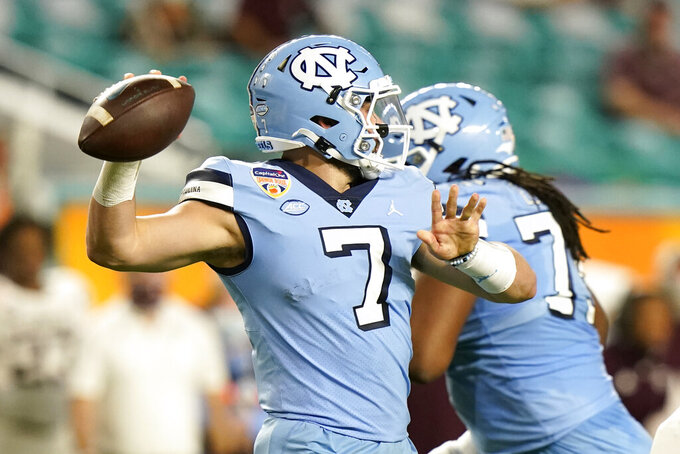 North Carolina quarterback Sam Howell (7) stands back to pass during the first half of the Orange Bowl NCAA college football game against Texas A&M, Saturday, Jan. 2, 2021, in Miami Gardens, Fla. (AP Photo/Lynne Sladky)