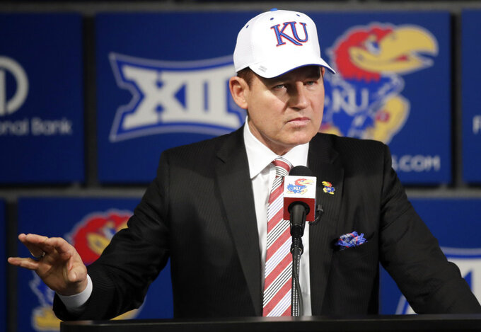 University of Kansas new football coach Les Miles makes a statement during a news conference in Lawrence, Kan., Sunday, Nov. 18, 2018. (AP Photo/Orlin Wagner)