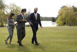 Britain's Foreign Secretary Dominic Raab, right, walks with Japan's Foreign Minister Toshimitsu Motegi, centre, during their talks in Kent, southern England, Monday May 3, 2021. (Tom Nicholson/Pool via AP)