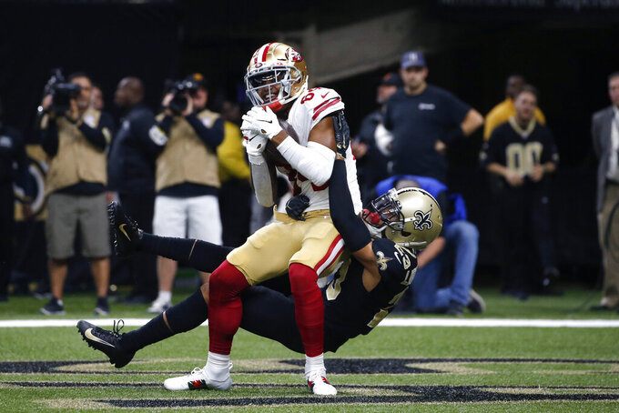 San Francisco 49ers wide receiver Kendrick Bourne (84) plus in a touchdown reception as New Orleans Saints cornerback Marshon Lattimore (23) covers in the first half an NFL football game in New Orleans, Sunday, Dec. 8, 2019. (AP Photo/Butch Dill)