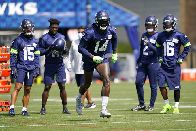 Seattle Seahawks wide receiver DK Metcalf (14) runs a practice drill during NFL football training camp, Wednesday, Aug. 12, 2020, in Renton, Wash. (AP Photo/Ted S. Warren, Pool)