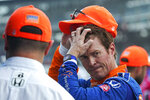 Scott Dixon, of New Zealand, reacts during qualifying for the IndyCar auto race at Indianapolis Motor Speedway, Friday, Aug. 13, 2021, in Indianapolis. (AP Photo/Darron Cummings)