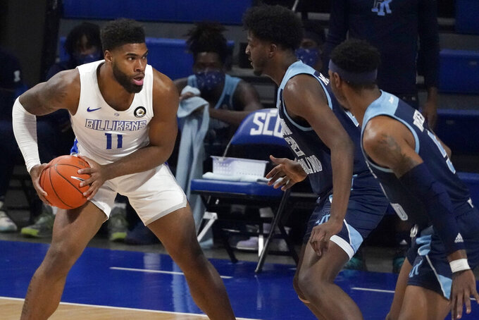 Saint Louis' Hasahn French (11) looks to pass as Rhode Island's Makhel Mitchell and Antwan Walker, right, defend during the first half of an NCAA college basketball game Wednesday, Feb. 10, 2021, in St. Louis. (AP Photo/Jeff Roberson)