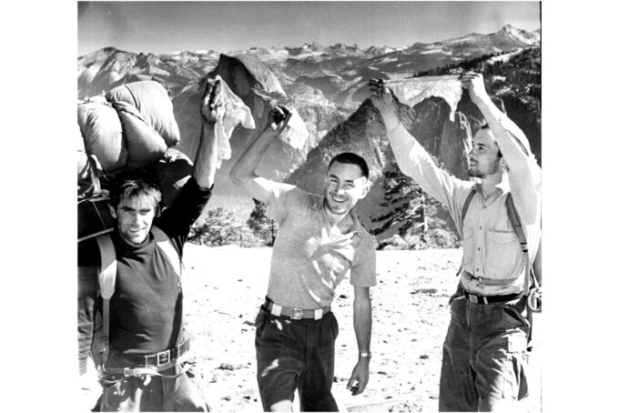 From left, Warren Harding, Wayne Merry and George Whitmore wave their handkerchiefs in elation at scaling the unclimbed face of El Capitan in Yosemite National Park in 1958. The picture was taken by Fresno Bee staff photographer Loyal Savaria within a few minutes after they walked up to the summit. Whitmore, a member of the first team of climbers to scale El Capitan in Yosemite National Park and a conservationist who devoted his life to protecting the Sierra Nevada, has died. He was 89. Whitmore died on New Year's Day from complications caused by COVID-19, said his wife, Nancy. (Loyal Savaria/Fresno Bee Archive via AP)