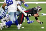 Dallas Cowboys defensive tackle Antwaun Woods (99) helps to stop Atlanta Falcons' Matt Ryan (2) from gaining extra yardage on a scramble in the first half of an NFL football game in Arlington, Texas, Sunday, Sept. 20, 2020. (AP Photo/Michael Ainsworth)