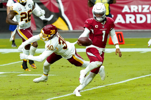 Arizona Cardinals quarterback Kyler Murray (1) runs for a touchdown as Washington Football Team free safety Troy Apke (30) misses the tackle during the second half of an NFL football game, Sunday, Sept. 20, 2020, in Glendale, Ariz. (AP Photo/Ross D. Franklin)