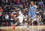 Virginia Tech guard Tyrece Radford (23) drives past North Carolina defender Armando Bacon (5) during the second half of an NCAA college basketball game in Blacksburg, Va., Wednesday, Jan. 22, 2020.(AP Photo/Lee Luther Jr.)