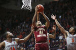 Boston College's Steffon Mitchell (41) past Virginia Tech's P.J. Horne (14) and Wabissa Bede (3) during the first half of an NCAA college basketball game, Saturday, Feb. 8 2020, in Blacksburg Va. (Matt Gentry/The Roanoke Times via AP)