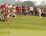 Britain's Paul Casey, top right, chips from the edge of the 11th green during the opening round of the Australian Open golf tournament in Sydney, Thursday, Dec. 5, 2019. (AP Photo/Rick Rycroft)