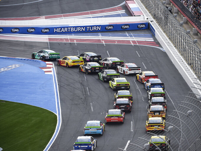 William Byron (24) leads through Turn 1 at the start of a NASCAR Cup Series auto race at Charlotte Motor Speedway, Sunday, Sept. 29, 2019, in Concord, N.C. (AP Photo/Mike McCarn)