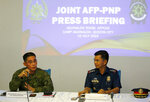 Philippine Armed Forces Spokesperson Brig.Gen. Edgard Arevalo, left, and his counterpart in the Philippine National Police PCol. Bernard Banac answer questions from the media during a joint news conference at Camp Aguinaldo Wednesday, July 10, 2019 in suburban Quezon city northeast of Manila, Philippines, on last month's bombing incident at a military camp in Indanan township on Jolo island, Sulu province in southern Philippines. Both Arevalo and Banac say a DNA test has confirmed the identity of the first known Filipino suicide bomber named as Norman Lasuca. Two attackers carrying explosives killed three soldiers, two villagers and themselves and wounded 22 others in a June 28 attack on an army camp in southern Sulu province. The second attacker remains unidentified. (AP Photo/Bullit Marquez)