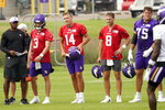 Minnesota Vikings quarterbacks Jake Browning, Nate Stanley and Kirk Cousins, from left, wait their turns at passing drills during the NFL football team's training camp Thursday, Aug. 5, 2021, in Eagan, Minn. (AP Photo/Jim Mone)