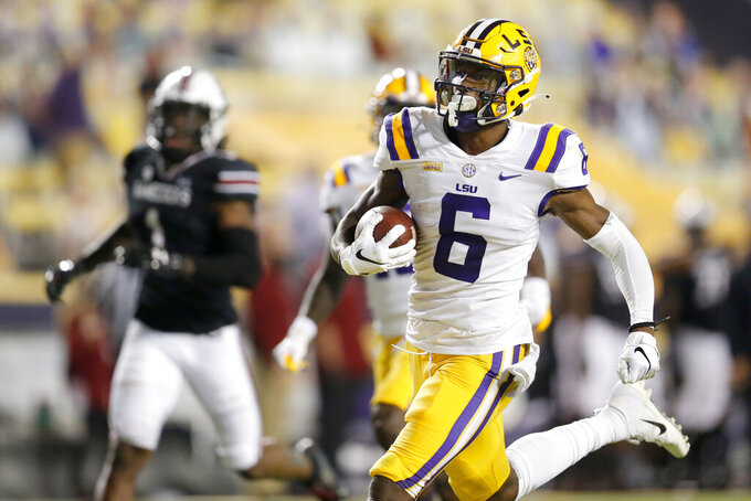 FILE - In this Saturday, Oct. 24, 2020 file photo, LSU wide receiver Terrace Marshall Jr. (6) runs the ball for a touchdown against South Carolina during the first half of an NCAA college football game in Baton Rouge, La.  Baltimore ranked last in the NFL averaging 171.2 yards passing per game and had the fewest pass attempts with 406 last season. That's partly because the running game was so proficient behind quarterback Lamar Jackson, the catalyst for the league's No. 1 rushing attack (191.9 yards per game) for the second straight season.(AP Photo/Brett Duke, File)