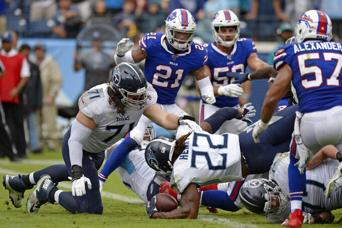 Tennessee Titans running back Derrick Henry (22) dives over the goal line on a 1-yard run for a touchdown against the Buffalo Bills in the second half of an NFL football game Sunday, Oct. 6, 2019, in Nashville, Tenn. (AP Photo/Mark Zaleski)