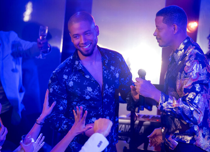 This image released by Fox shows Jussie Smollett, left, and Terrence Howard in a scene from the