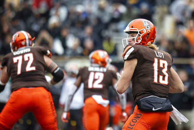 Bowling Green Falcons quarterback Grant Loy (13) drops back for a pass attempt against Western Michigan Broncos during the second quarter of an NCAA college football game in Kalamazoo, Mich., on Saturday, Oct. 26, 2019. (Joel Bissell/Kalamazoo Gazette via AP)