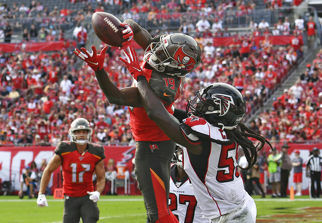 FILE - In this Dec. 29, 2019, file photo, Tampa Bay Buccaneers wide receiver Breshad Perriman (19) pulls in a 24-yard touchdown reception in front of Atlanta Falcons outside linebacker De'Vondre Campbell (59) during the first half of an NFL football game in Tampa, Fla. Perriman agreed to terms Tuesday with the New York Jets on a one-year deal worth up to $8 million and includes $6 million guaranteed, agent Drew Rosenhaus told The Associated Press. (AP Photo/Jason Behnken, File)