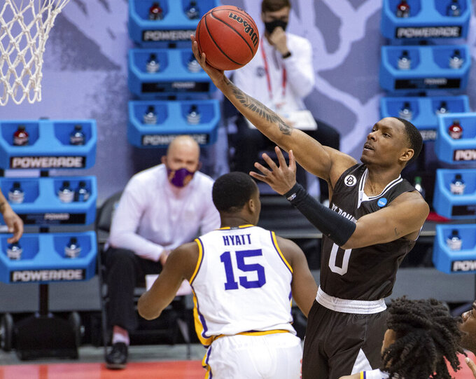 St. Bonaventure guard Kyle Lofton (0) puts up a shot during the first half of a first round game against LSU in the NCAA men's college basketball tournament, Saturday, March 20, 2021, at Assembly Hall in Bloomington, Ind. (AP Photo/Doug McSchooler)