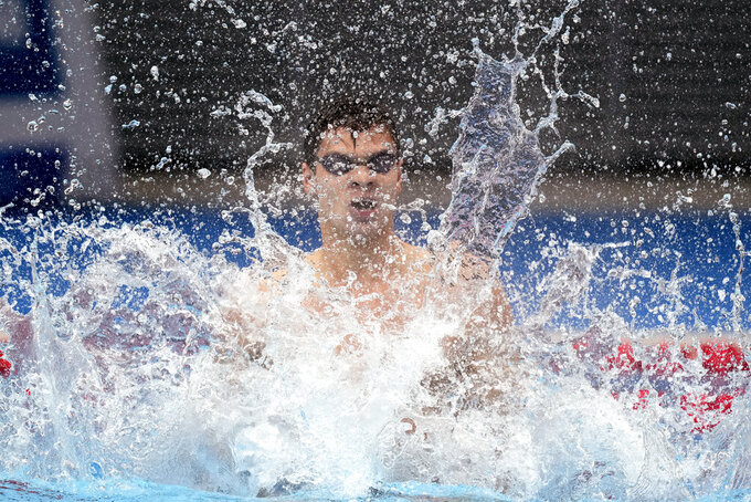 Evgeny Rylov of the Russian Olympic Committee celebrates after winning the final of the men's 100-meter backstroke final at the 2020 Summer Olympics, Tuesday, July 27, 2021, in Tokyo, Japan. (AP Photo/Martin Meissner)