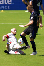 Toronto FC midfielder Michael Bradley, left, slides in to tackle the ball from CF Montreal midfielder Djordje Mihailovic the second half of an MLS soccer match, Saturday, April 17, 2021, in Fort Lauderdale, Fla. CF Montreal won 4-2. (AP Photo/Lynne Sladky)