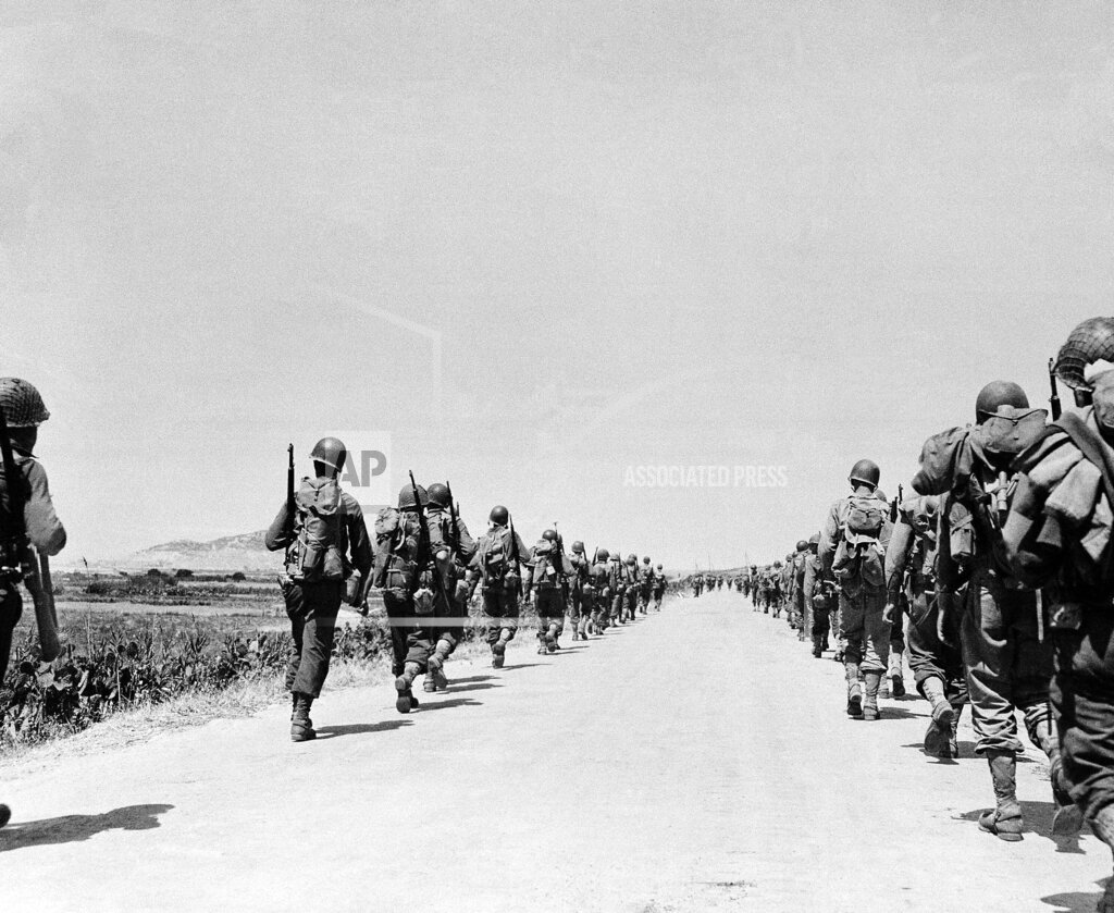 Watchf AP I   ITA APHS53063 US Troops March On Sicily