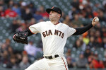 San Francisco Giants pitcher Andrew Suarez throws to an Atlanta Braves batter during the first inning of a baseball game in San Francisco, Monday, May 20, 2019. (AP Photo/Jeff Chiu)