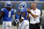 FILE - In this Oct. 13, 2018, file photo, Memphis head coach Mike Norvell watches players warm up before an NCAA college football game against Central Florida, in Memphis, Tenn. The seventh-ranked Knights (11-0, 8-0, No. 8 CFP) are one victory away from their second straight American Athletic Conference championship, a likely New Year's Six bowl bid and bolstering their argument that they are deserving of consideration for a berth in the College Football Playoff. None of that is possible, though, without beating Memphis (8-4, 5-3) in Saturday's AAC title game.(AP Photo/Mark Zaleski, File)